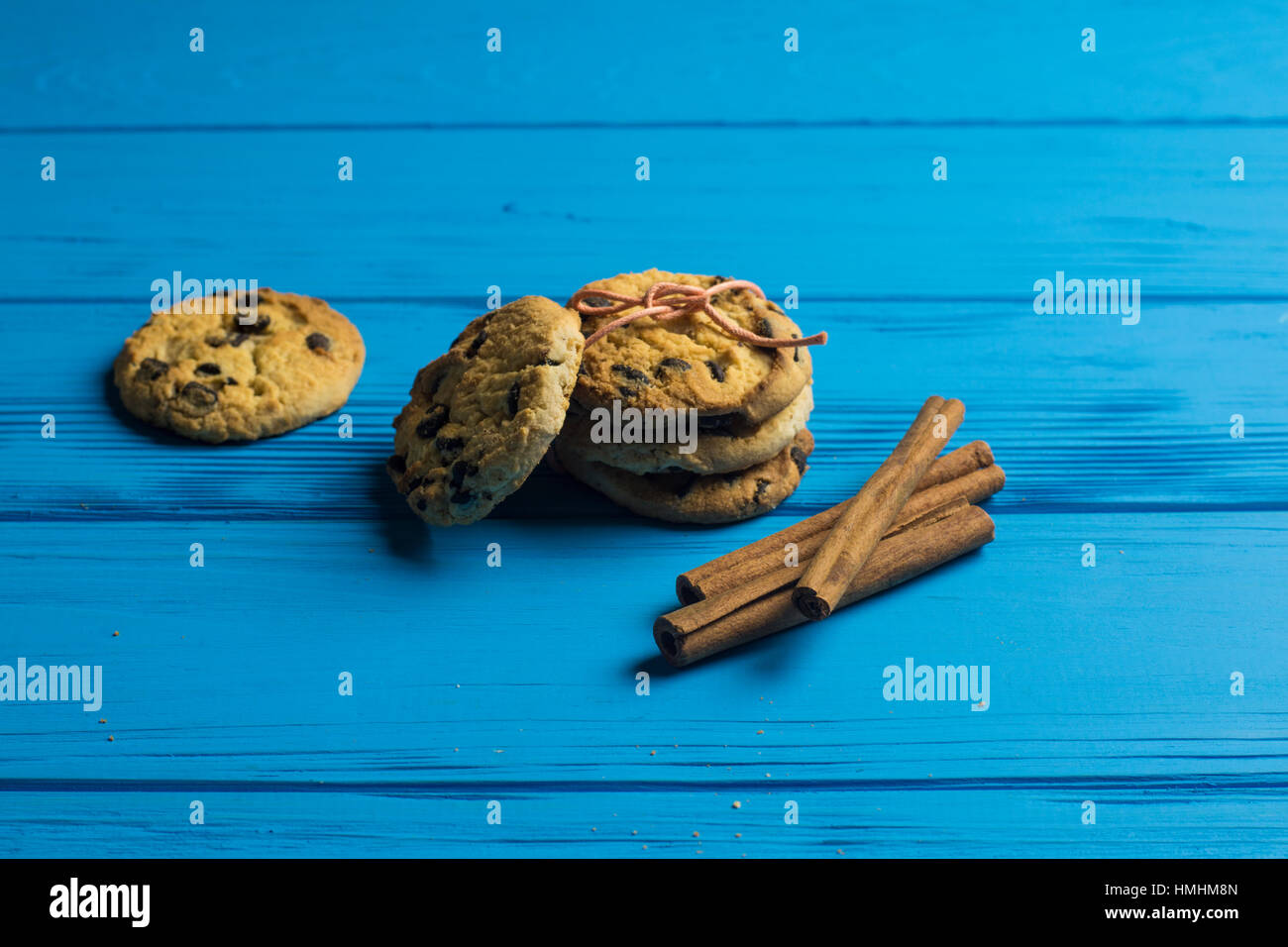 Cookies With Chocolate And Cinnamon Sticks On Blue Wooden Background