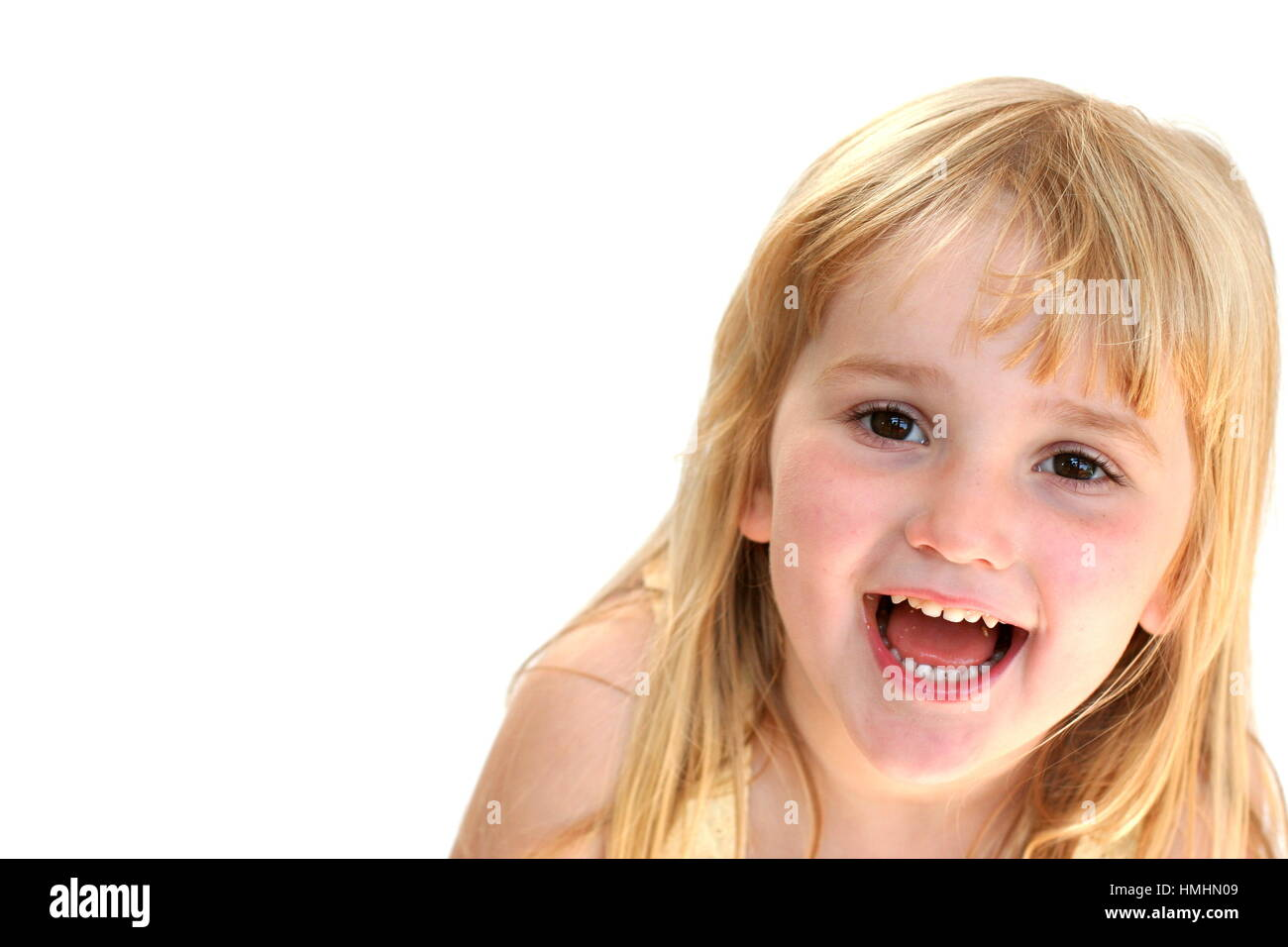Blonde 4 year old child, with long hair, happy messing funny face concept laugh out loud, happy happiness joy best Stock Photo