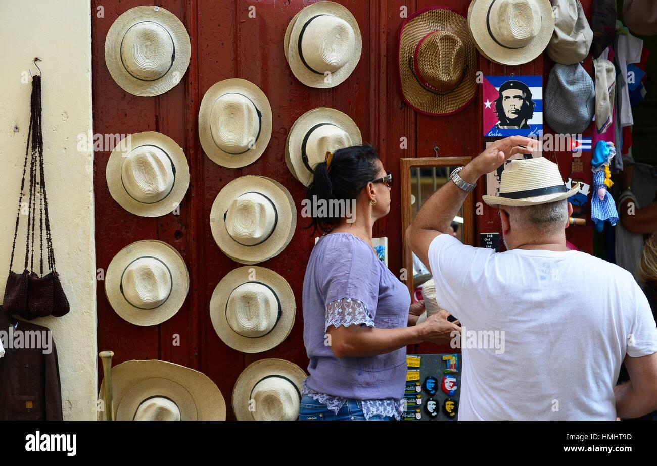 9352601213e Tourist trying straw hat in Havana
