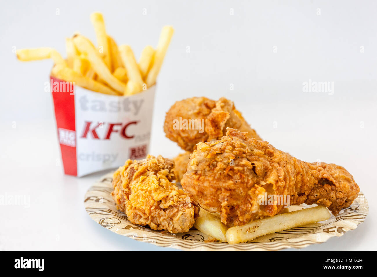 KFC meal, Kentucky Fried Chicken, French fries - Stock Image