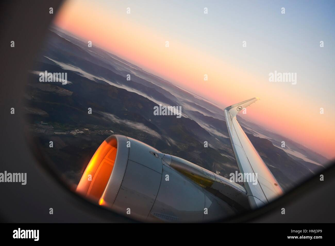 View from the Airplane Window at Sunset - Stock Image