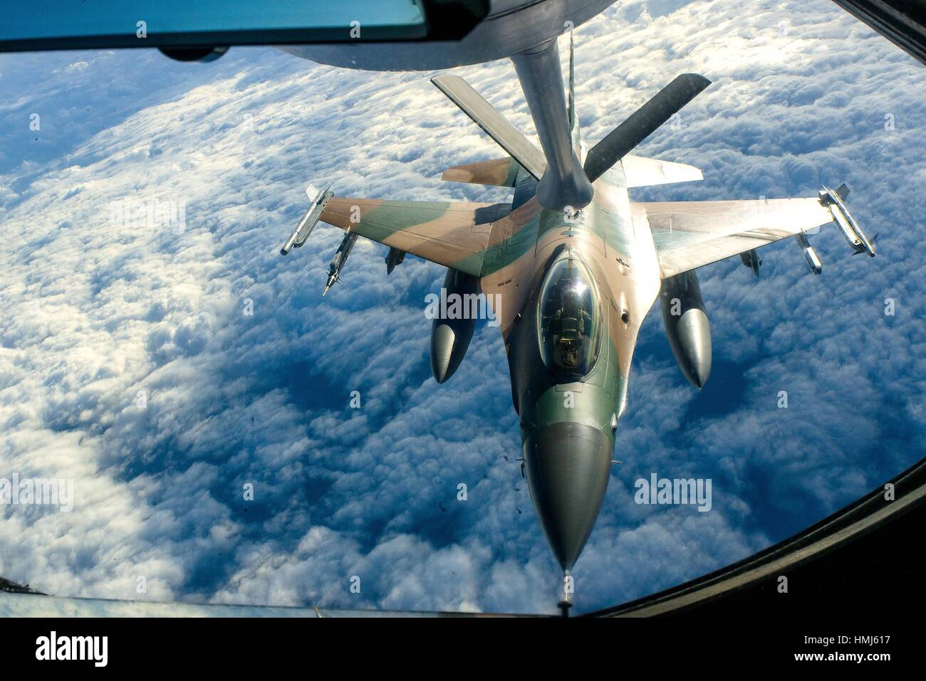 An Air Force F-16 Fighting Falcon aircraft refuels from a KC-135 Stratotanker during Forceful Tiger near Okinawa, - Stock Image