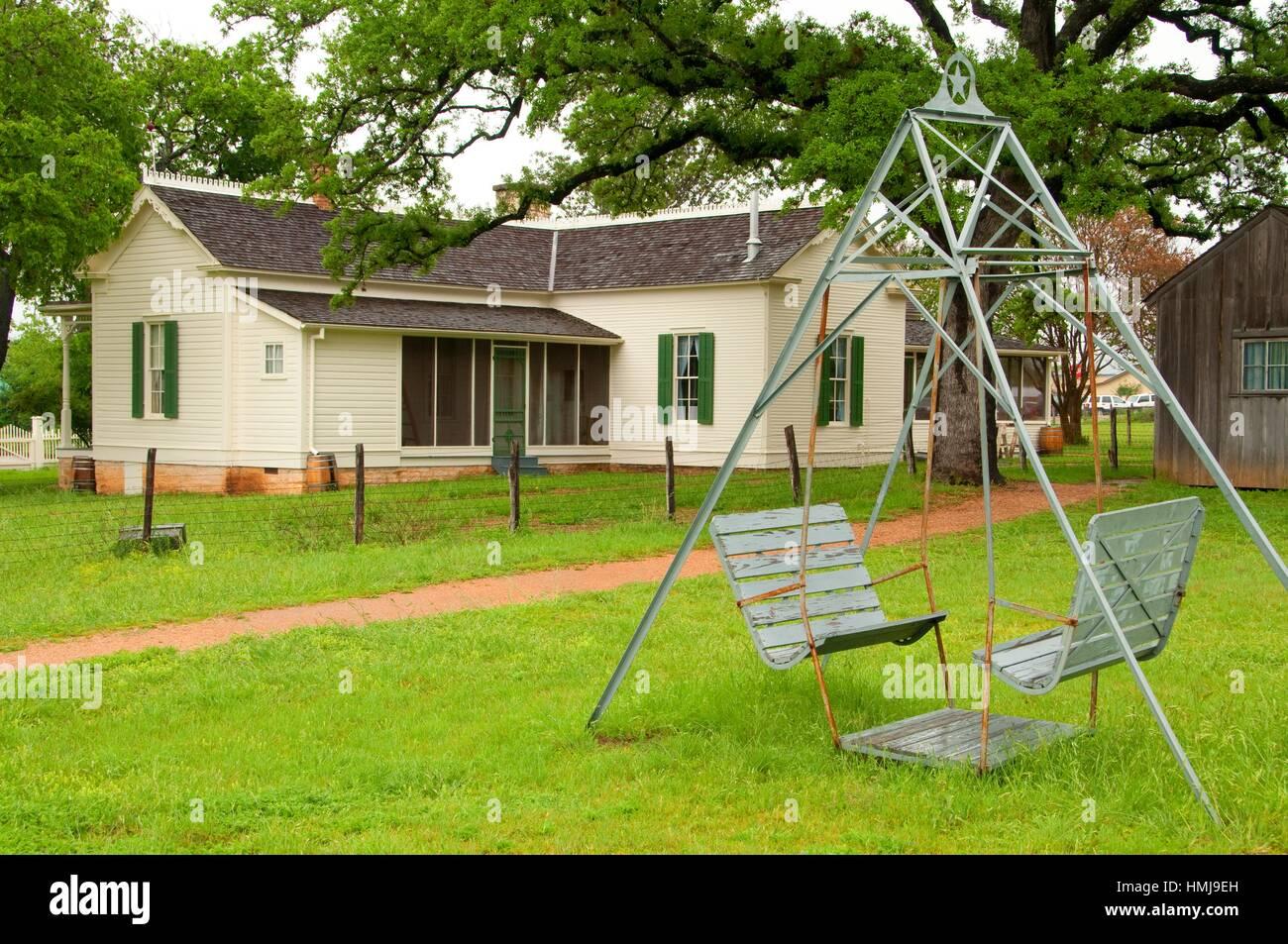 LBJ Boyhood Home with swing, Lyndon B. Johnson National Historical Park, Texas. Stock Photo