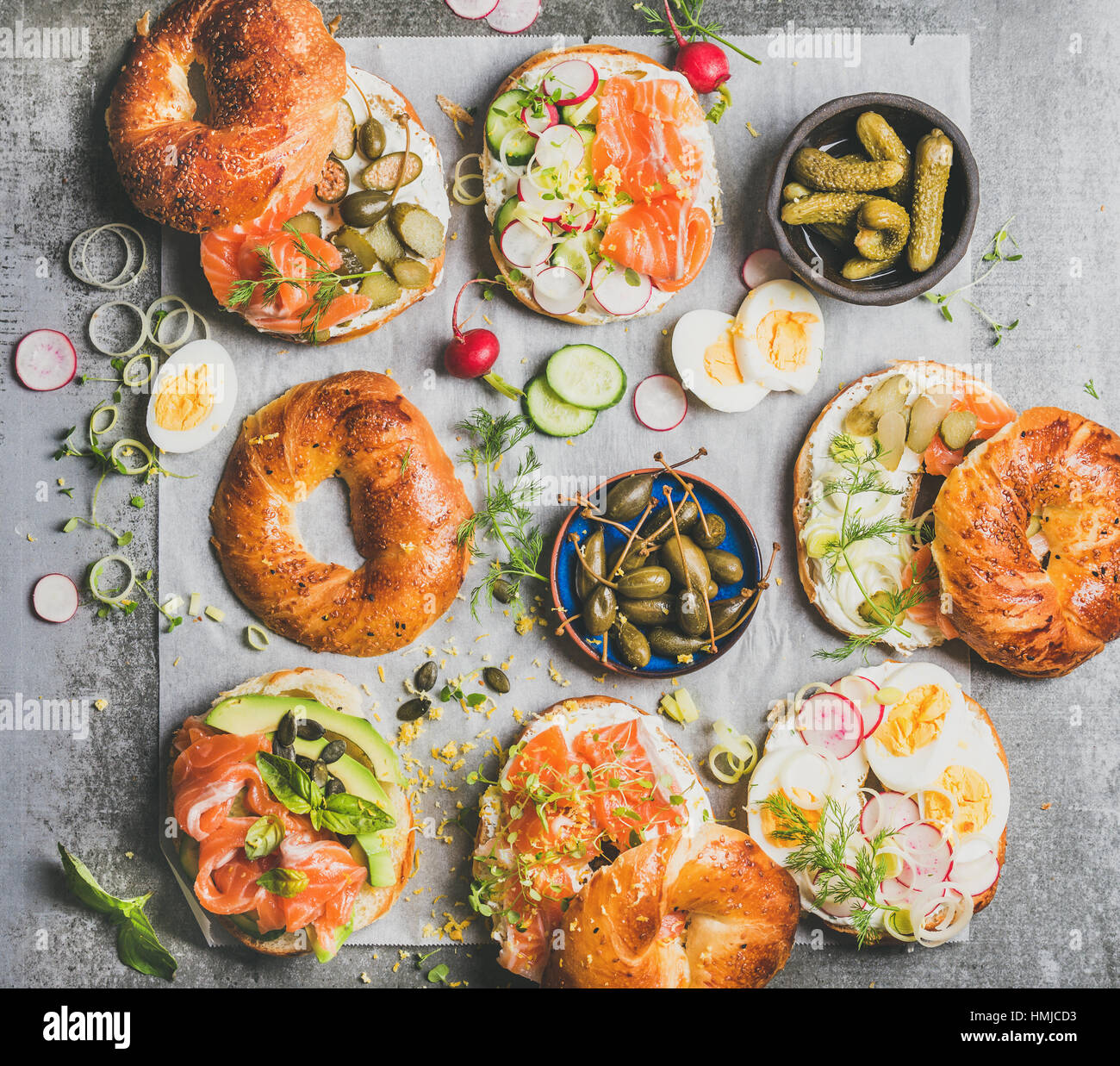 Variety of bagels with different fillings for breakfast or takeaway - Stock Image
