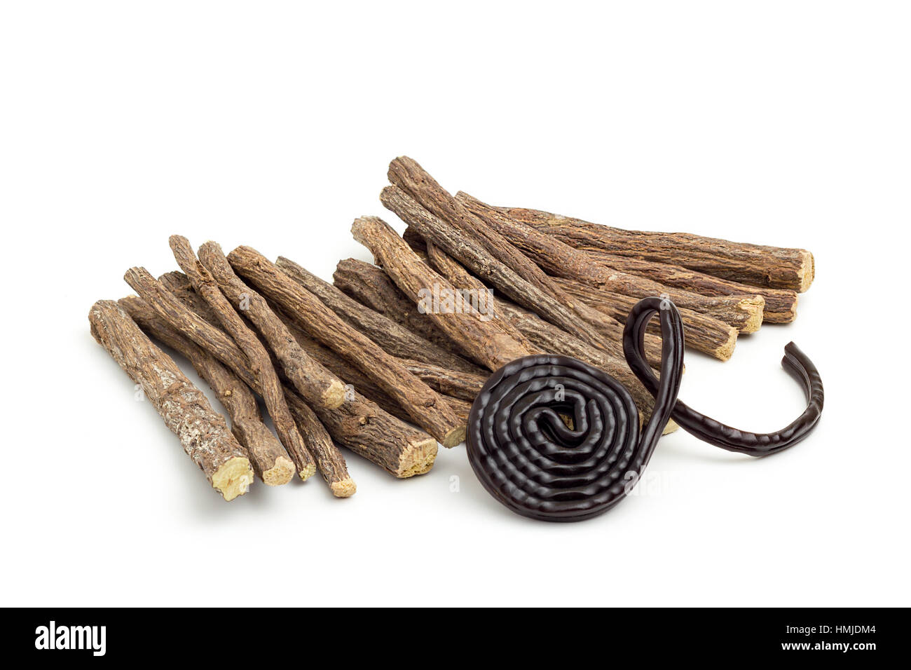 Liqorice roots and black wheel on white background - Stock Image