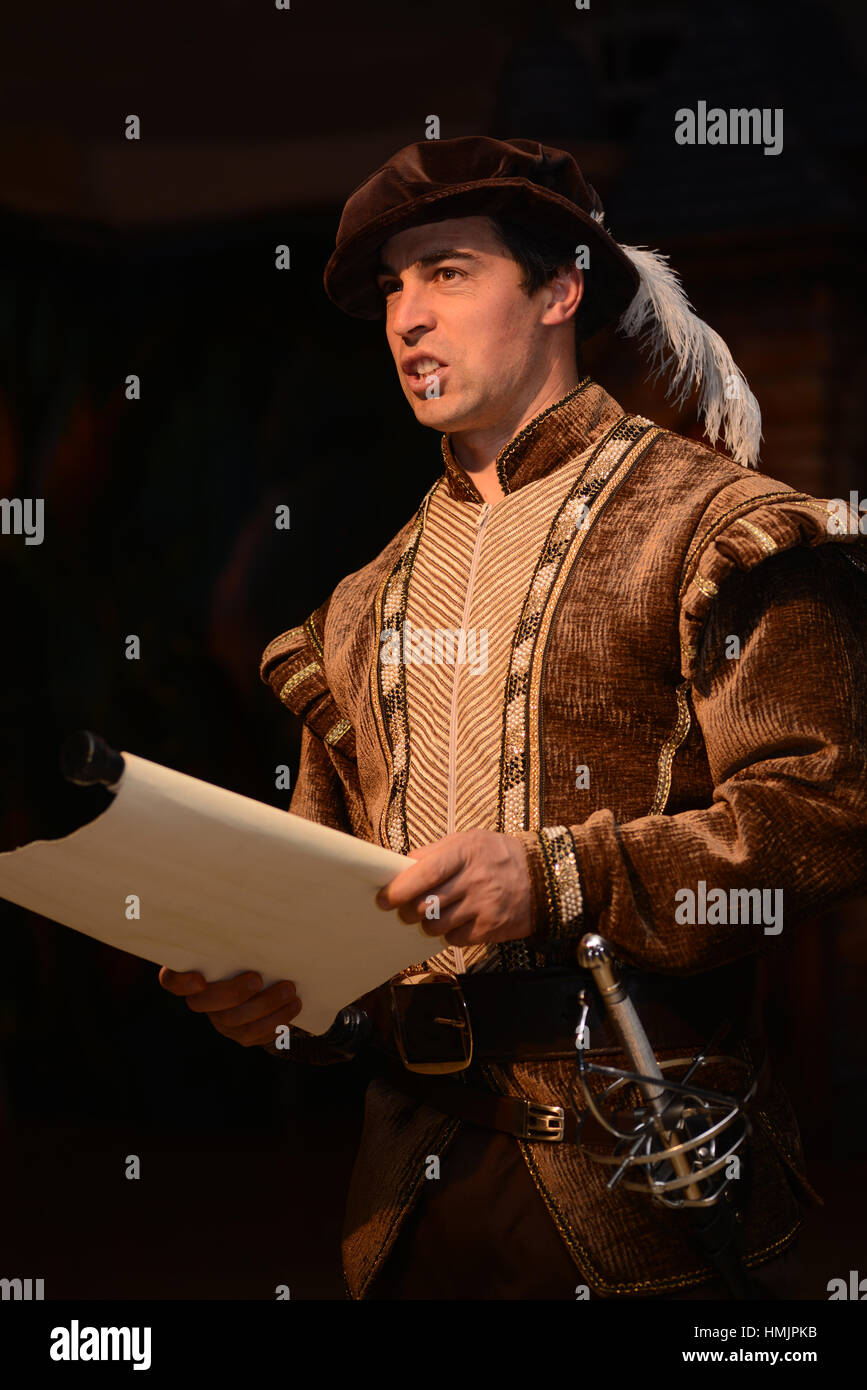 An actor in period costume makes an announcement - Stock Image