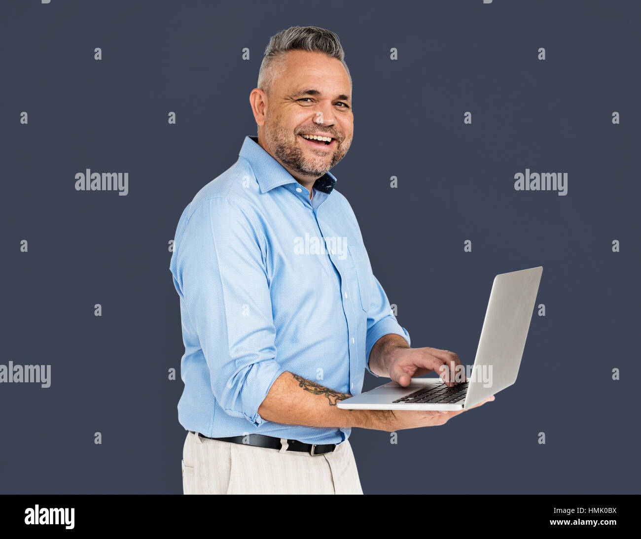 Cheerful Man Technology Gadget Concept - Stock Image
