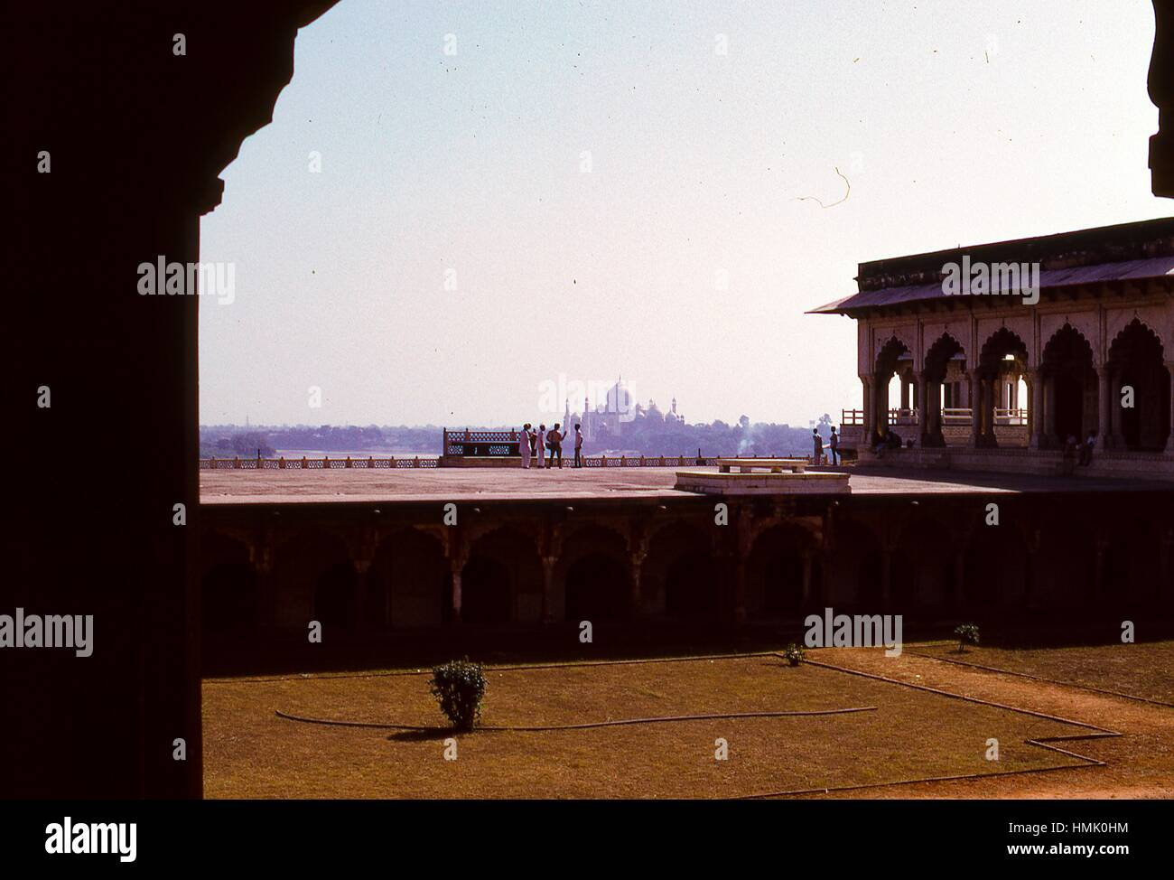 Panoramic view from the Agra Fort of the Taj Mahal at a great distance away in the background, November, 1973. Tourists - Stock Image