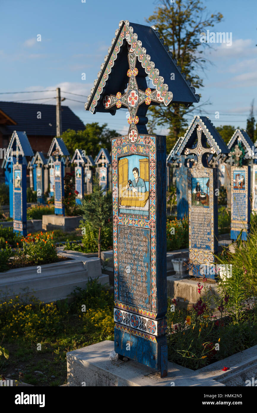 The Merry Cemetery, famous for its colourful tombstones covbered with naive paintings describing people who died - Stock Image