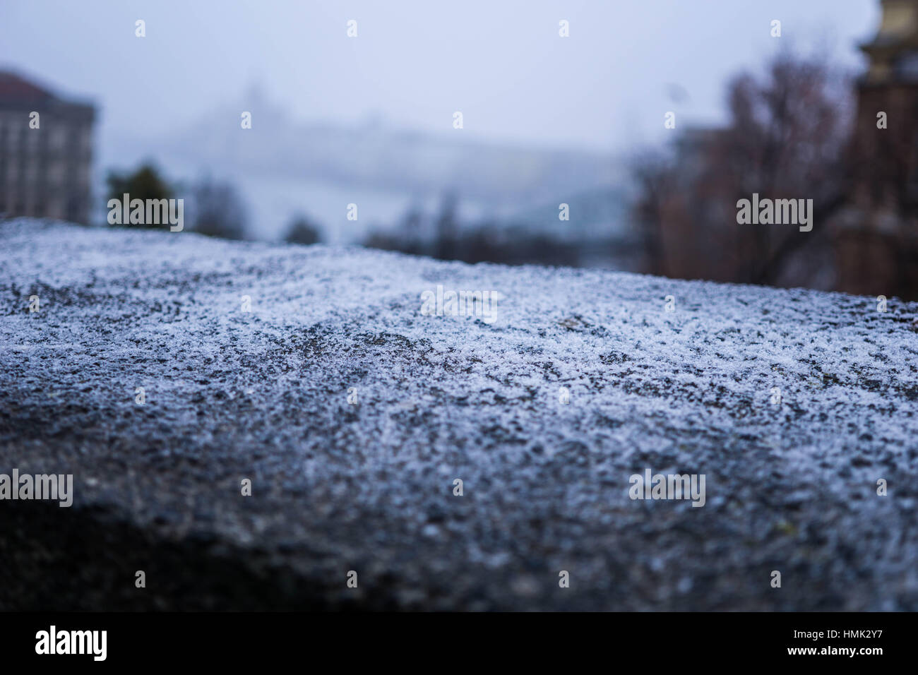 A shallow focus highlights frost on top of a stone wall - Stock Image