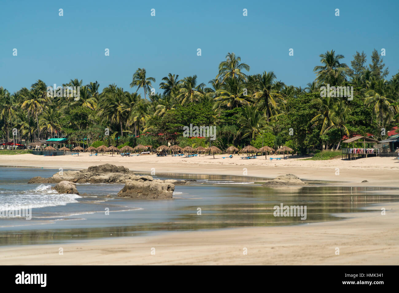 Sandy beach with palm trees, Ngwe Saung, Myanmar - Stock Image