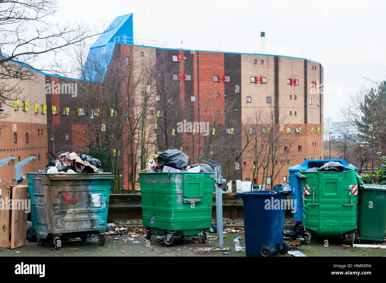 Rubbish bins in front of the Byker Wall, Newcastle. - Stock Image