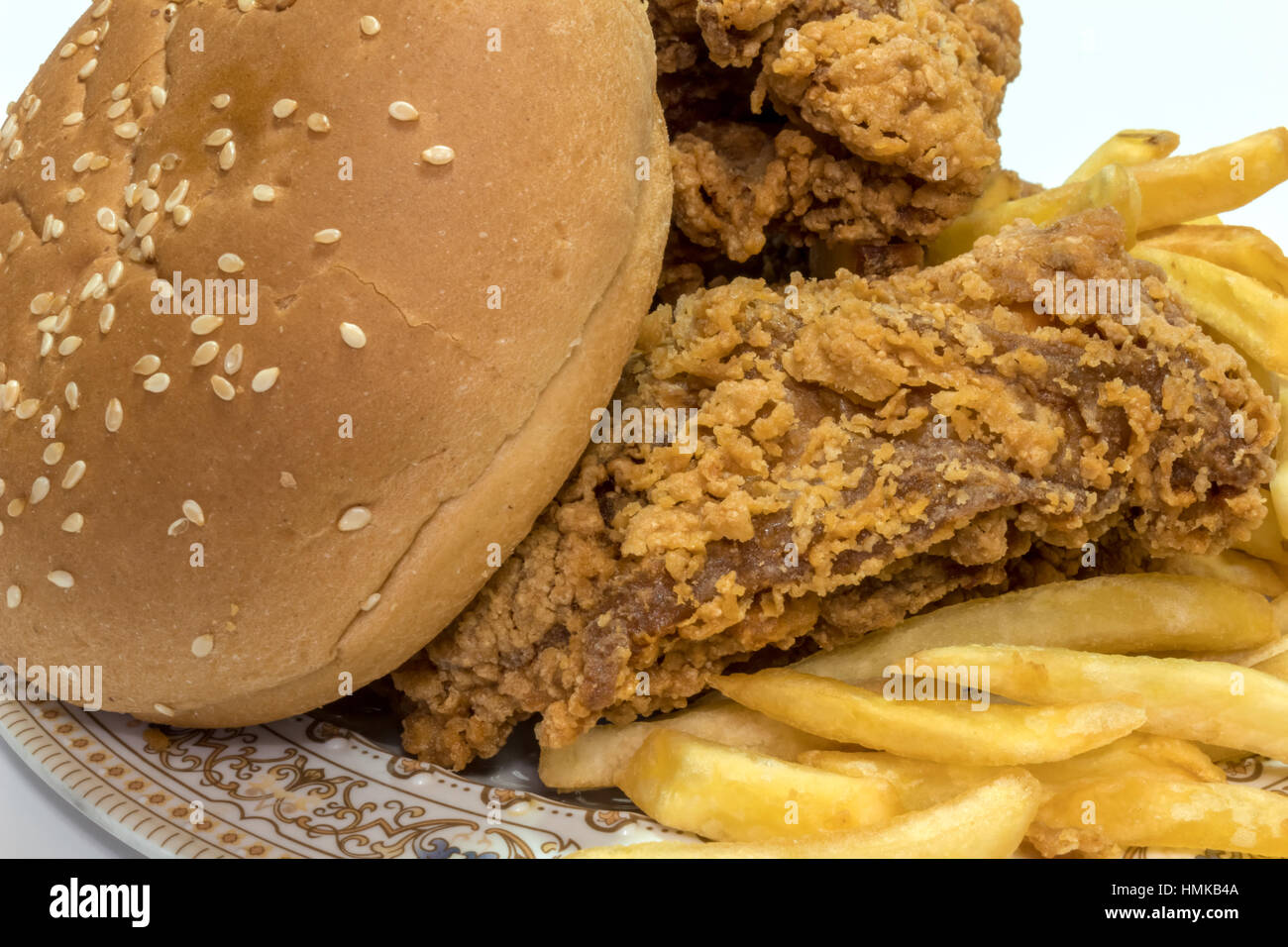 Tasty Fried potatoes with deep fried crunchy spicy chicken delicious - Stock Image