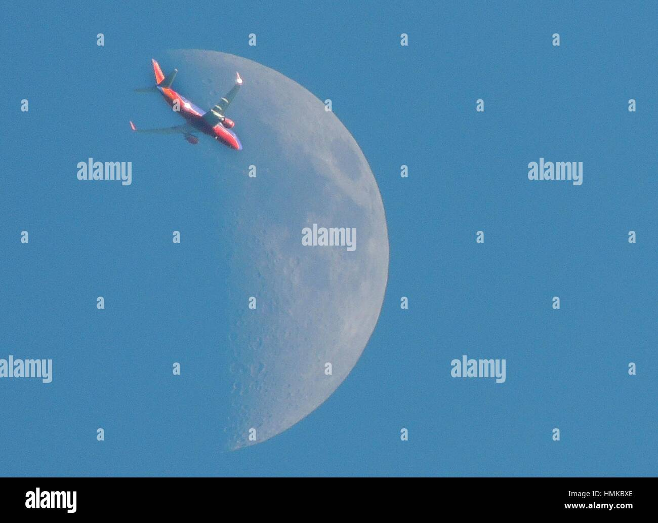 A colorful jetliner seems to head for the moon, Pennsylvania, USA. - Stock Image