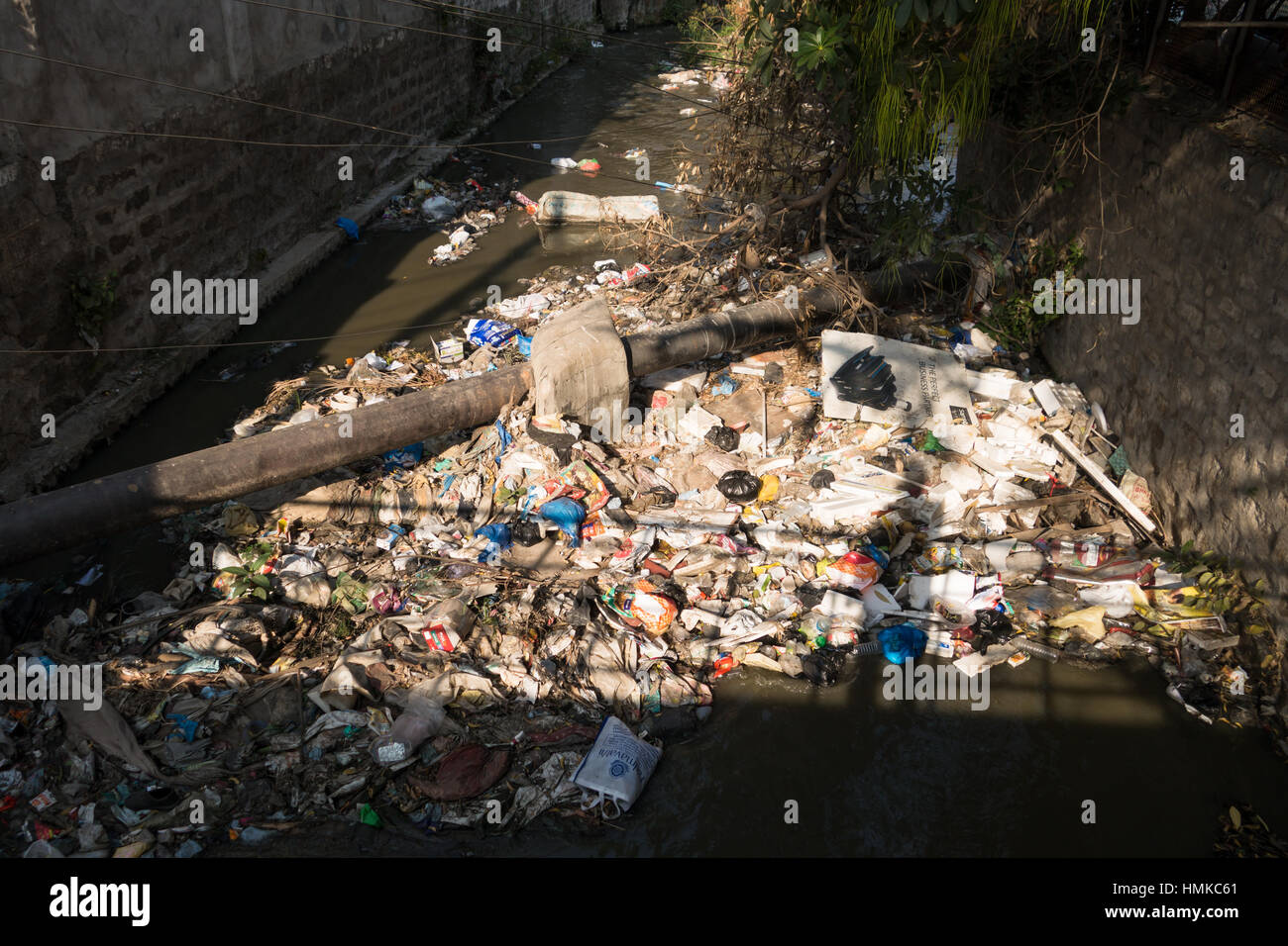 HYDERABAD, INDIA - FEBRUARY 03,2017  Sewage canal clogged by floating waste in Hyderabad,India - Stock Image