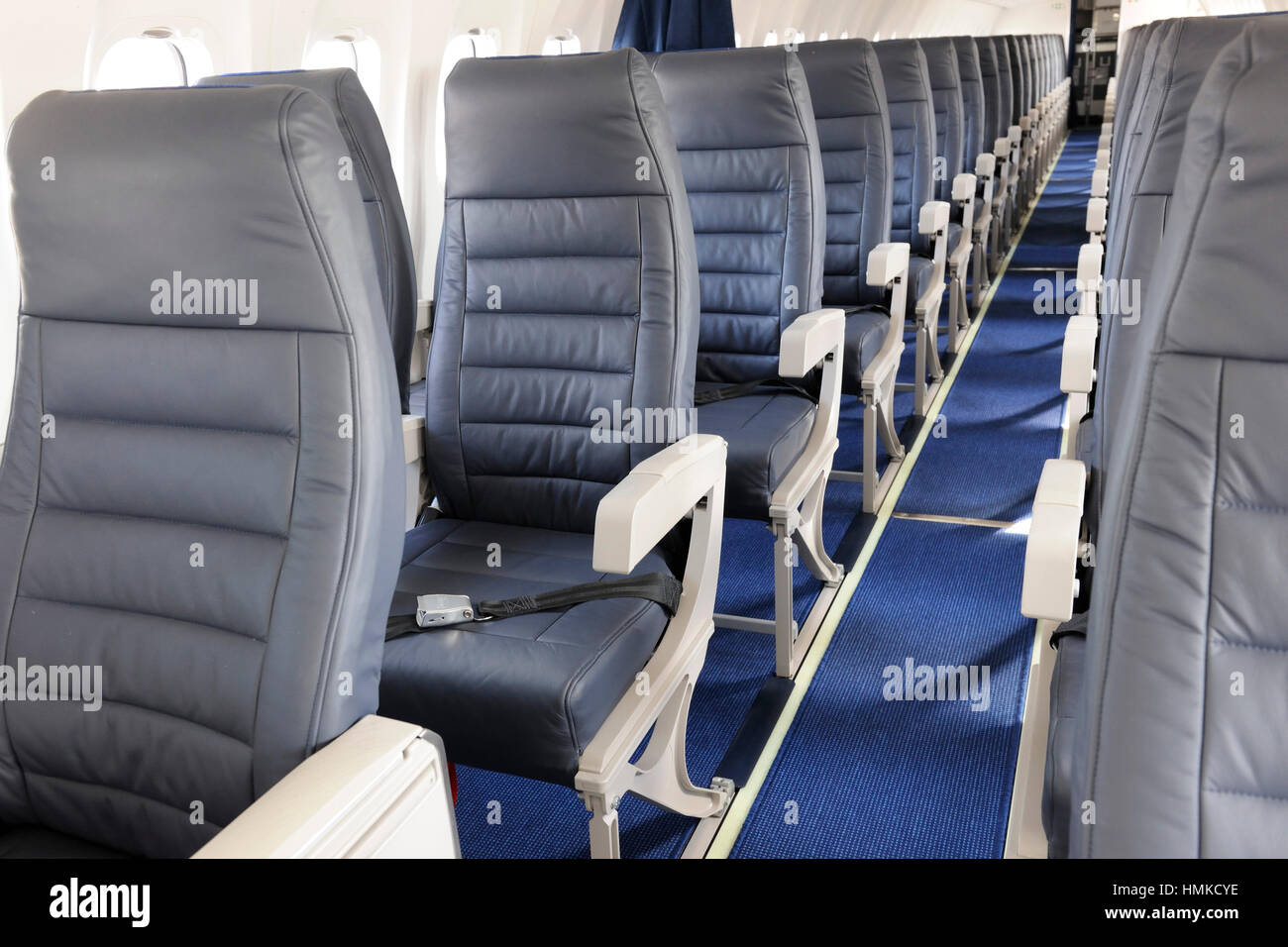 empty passenger cabin seats on AirBaltic Bombardier DHC-8 Q400 Next Generation parked in static-display at Singapore - Stock Image