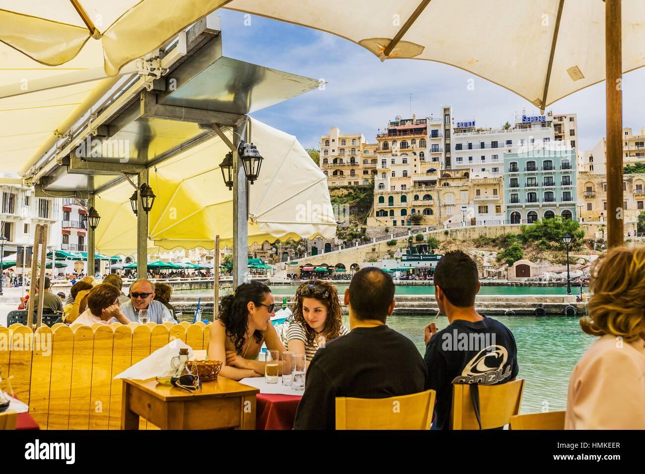 Eating in a restaurant near the village, Xlendi, Gozo, Malta - Stock Image