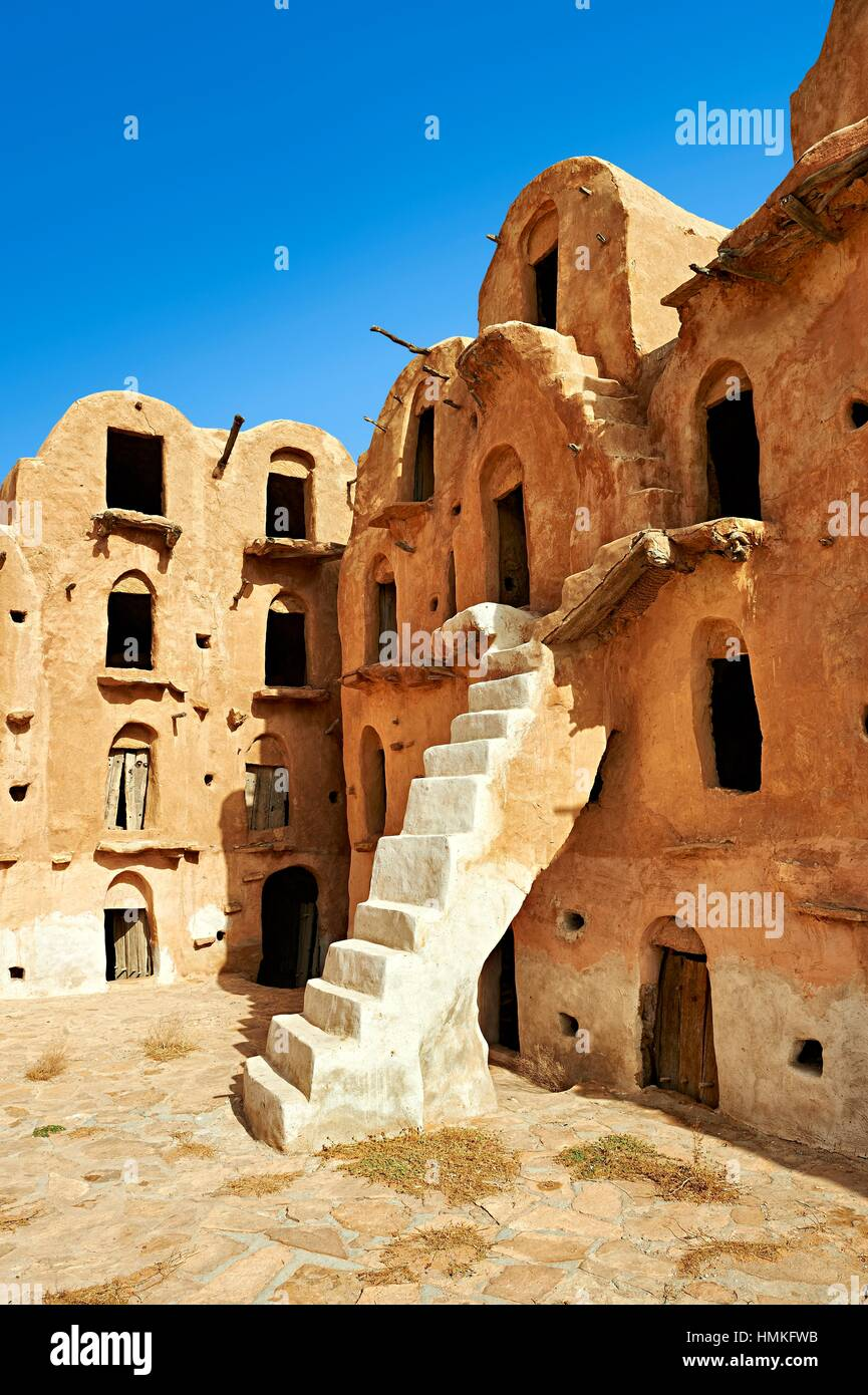 Ksar Ouled Soltane, a traditional Berber and Arab fortified adobe vaulted granary cellars, or ghorfas, situated Stock Photo