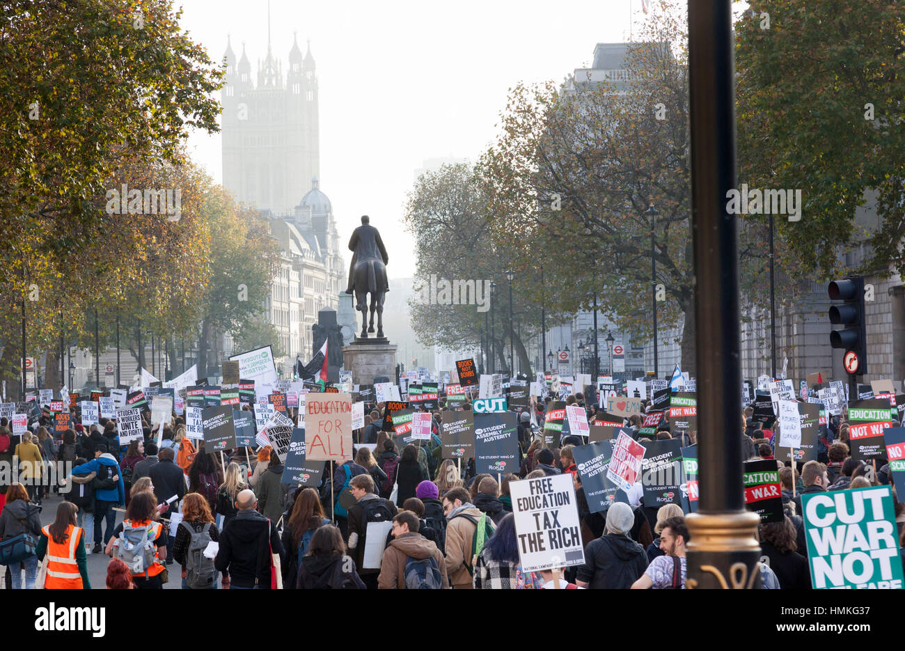 Student protest against education fees. They marched through London from Mallet Street through Whitehall to Parliiament - Stock Image