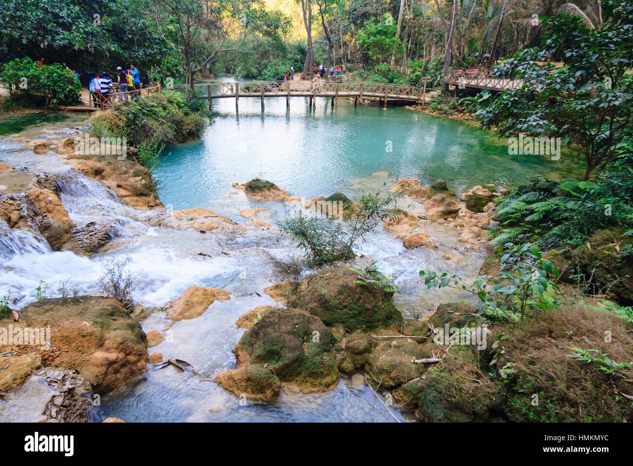 Pool and bridge at Kuang Si Waterfalls, 29 km south of Luang Prabang, Laos, South East Asia - Stock Image