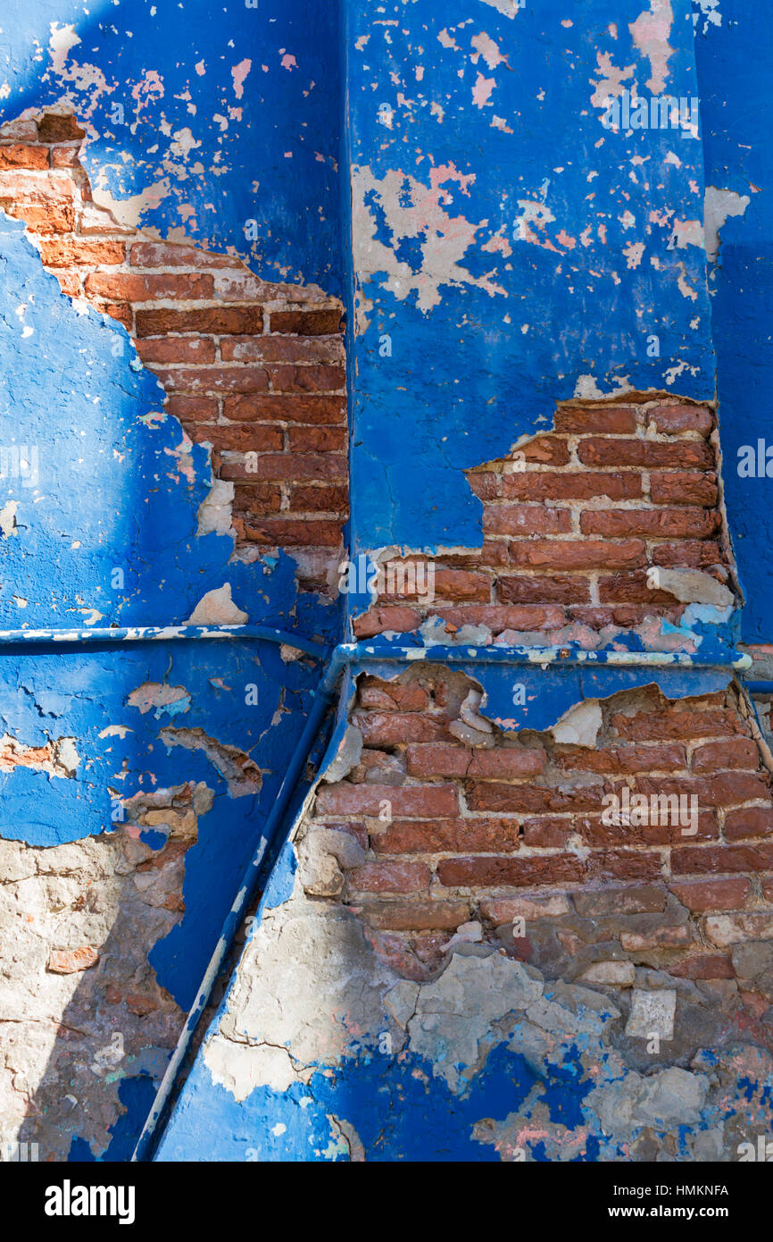 Building in need of some TLC with flaking paint and exposed brickwork at Burano, Venice, Italy in January - Stock Image