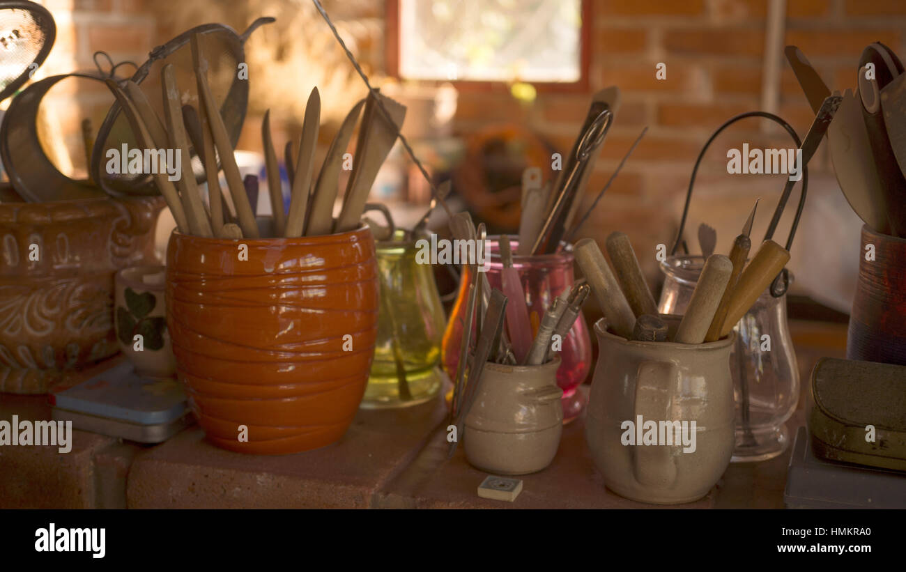 Set of tools in a pottery workshop - Stock Image