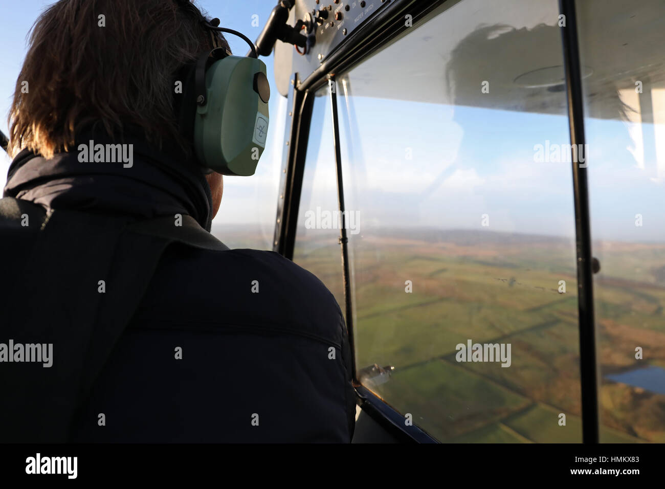 a view from inside the cockpit of a Piper Supercub PA18 light aircraft flying at 1500 feet - Stock Image