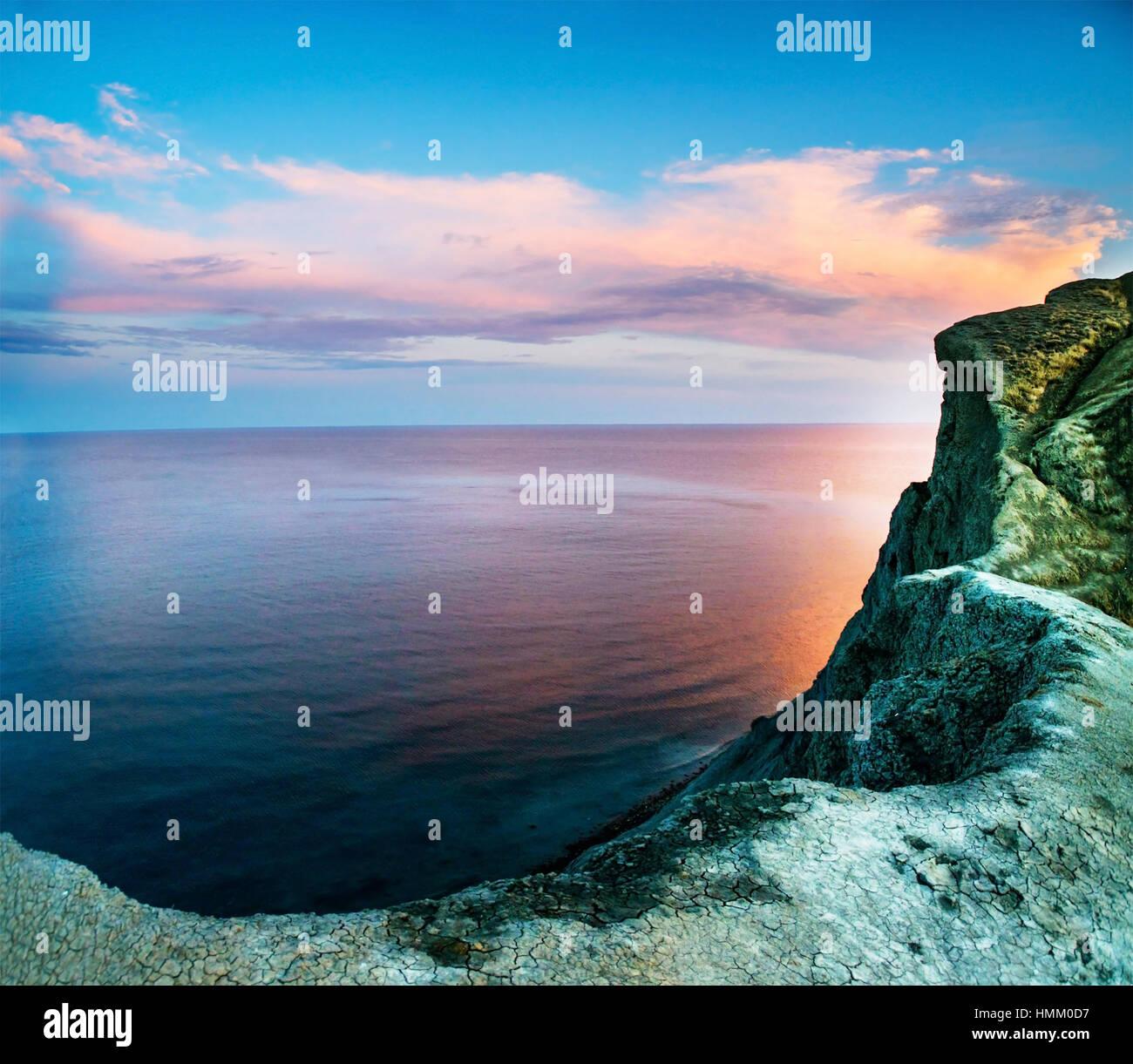 Rocks and sea. Dramatic scene. - Stock Image