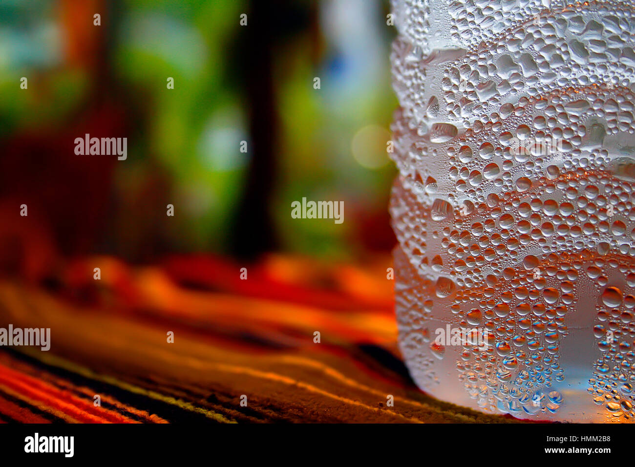 Bottle of water droplets sweat asia background - Stock Image