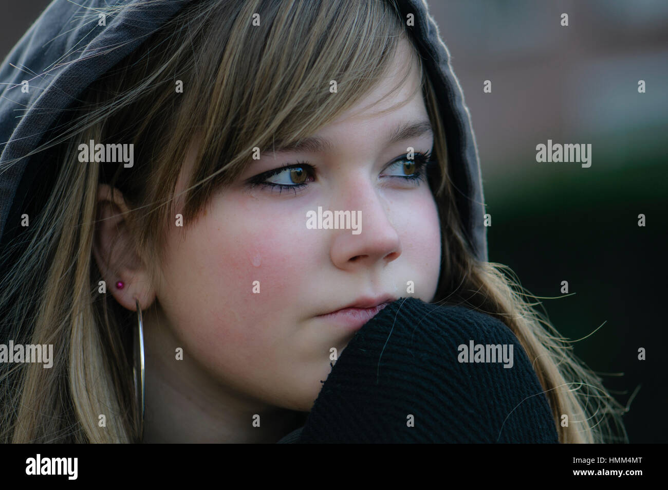 crying girl looks straight ahead and thinking - Stock Image