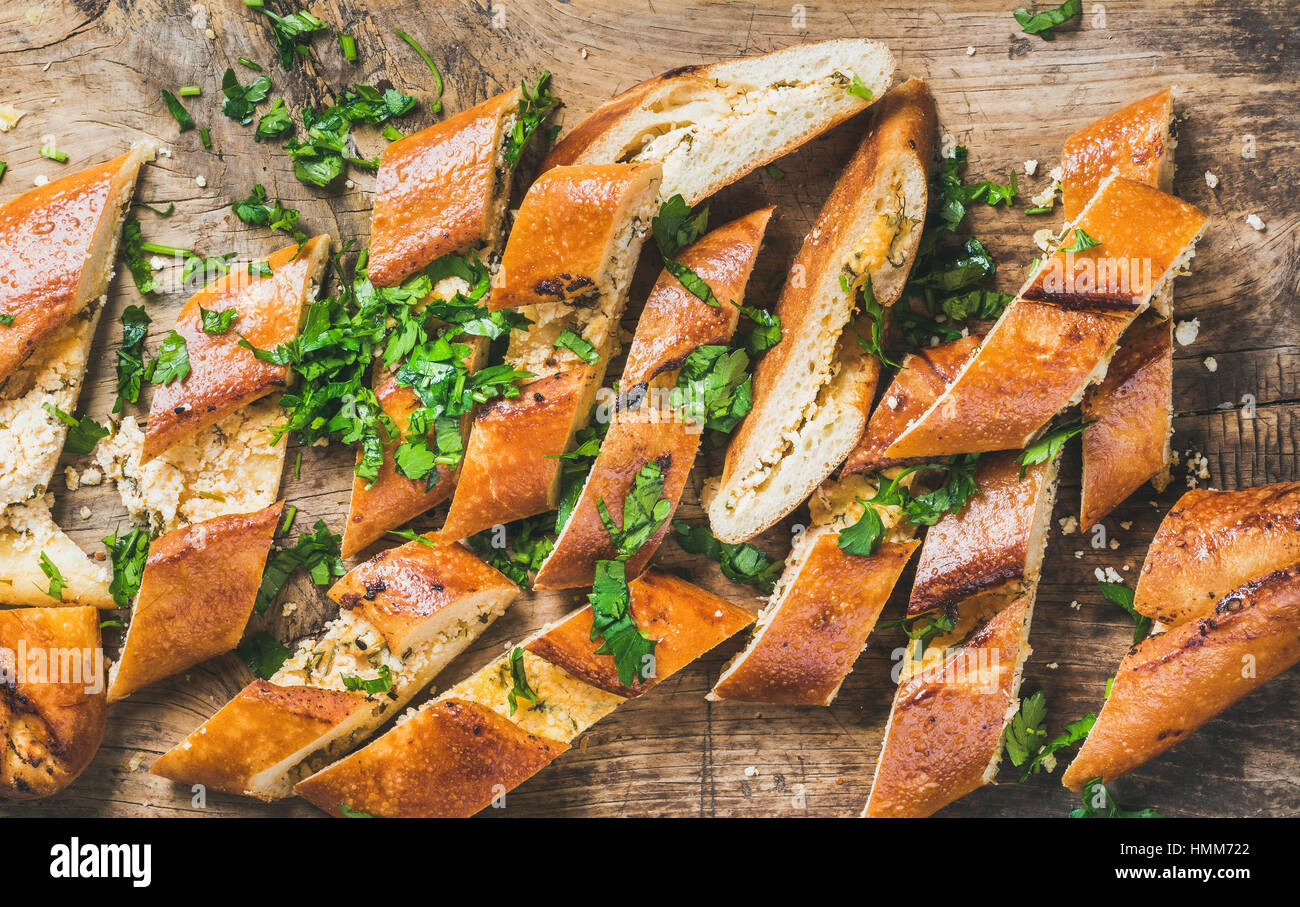 Close-up of chopped Turkish pizza pide with cheese and spinach - Stock Image