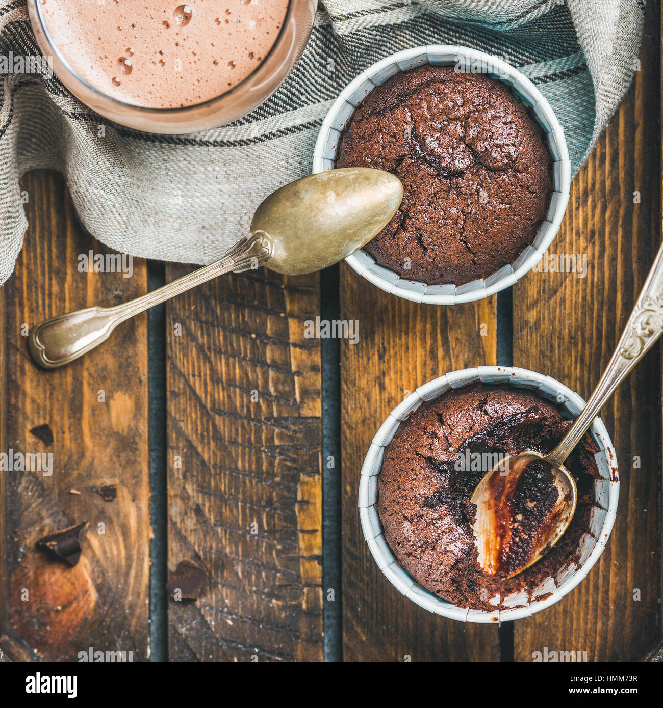 Chocolate souffle in baking cups and mocha coffee, square crop - Stock Image