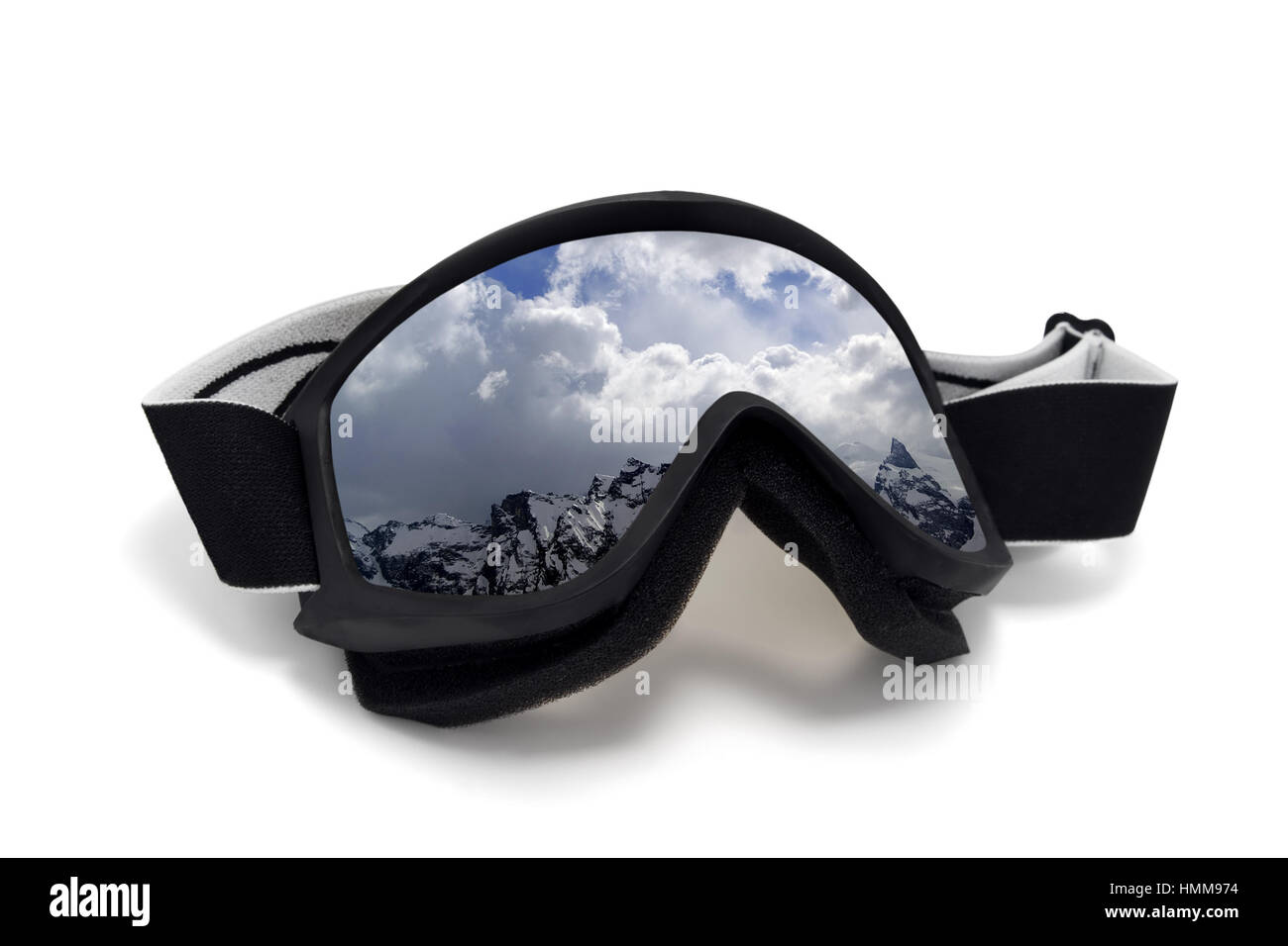 Ski goggles with reflection of winter snow mountains. Isolated on white background - Stock Image