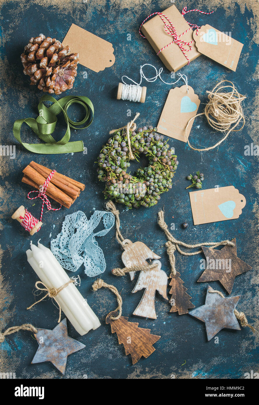 Christmas related objects on shabby table background, top view - Stock Image