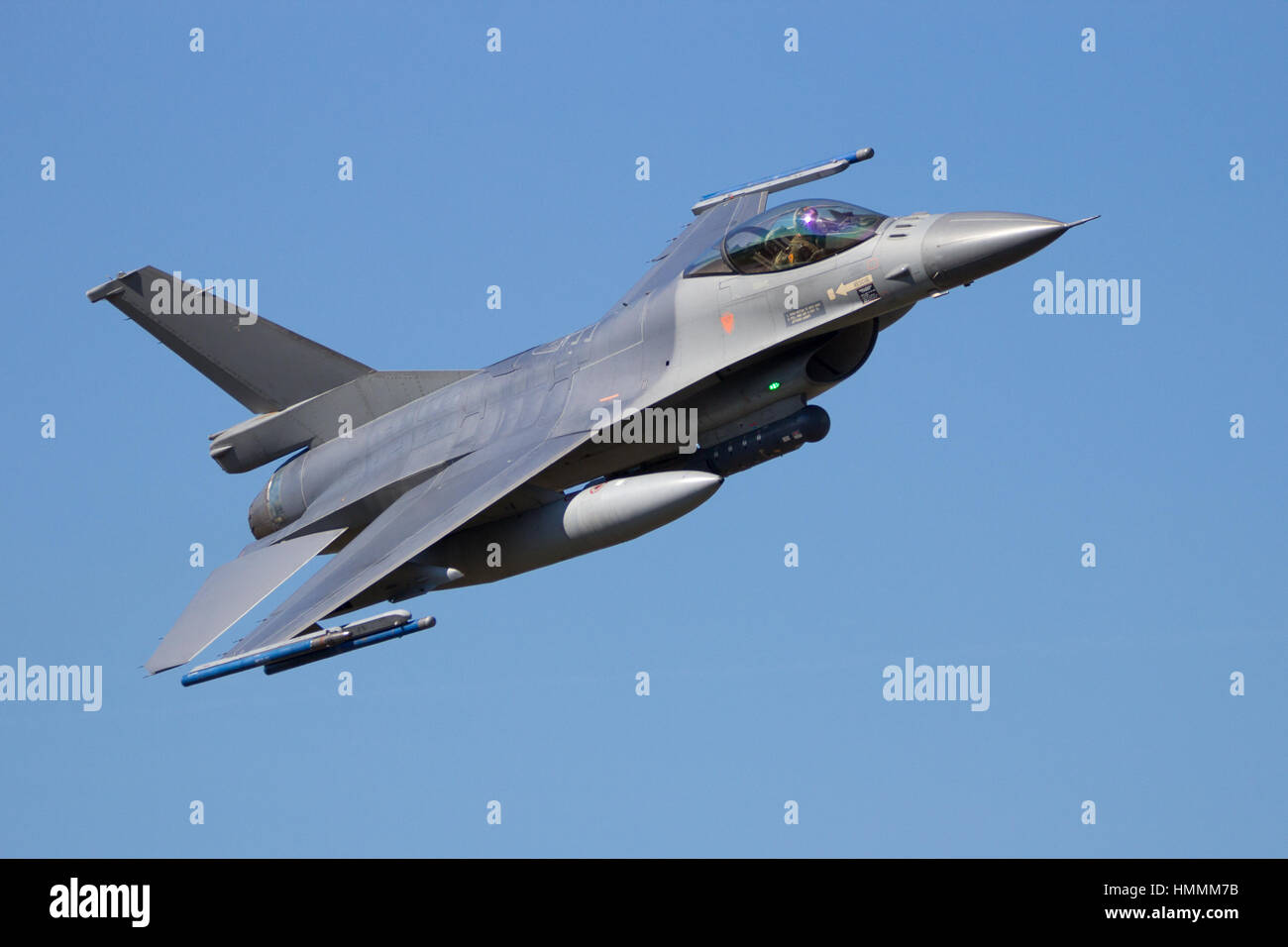 F-16 fighter jet making a fast and low flyby - Stock Image