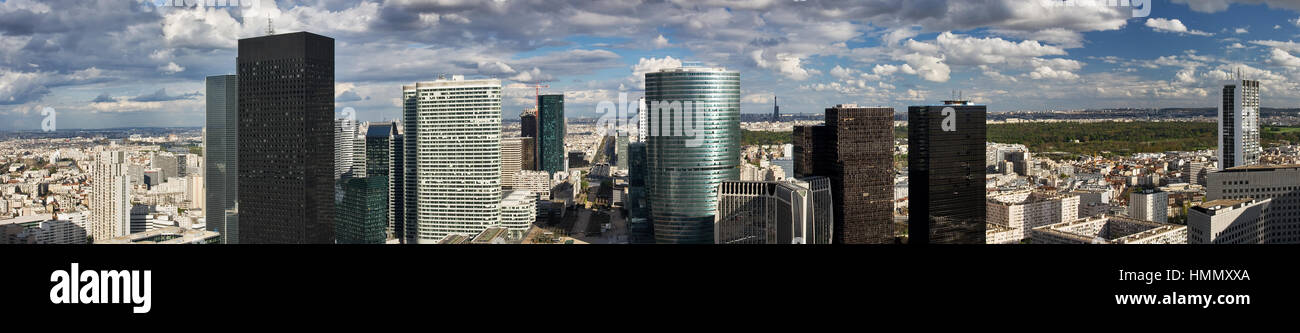 Skyscrapers and office buildings above the central pedestrian area in La Defense, Paris, leading to the Arc de Triomphe - Stock Image