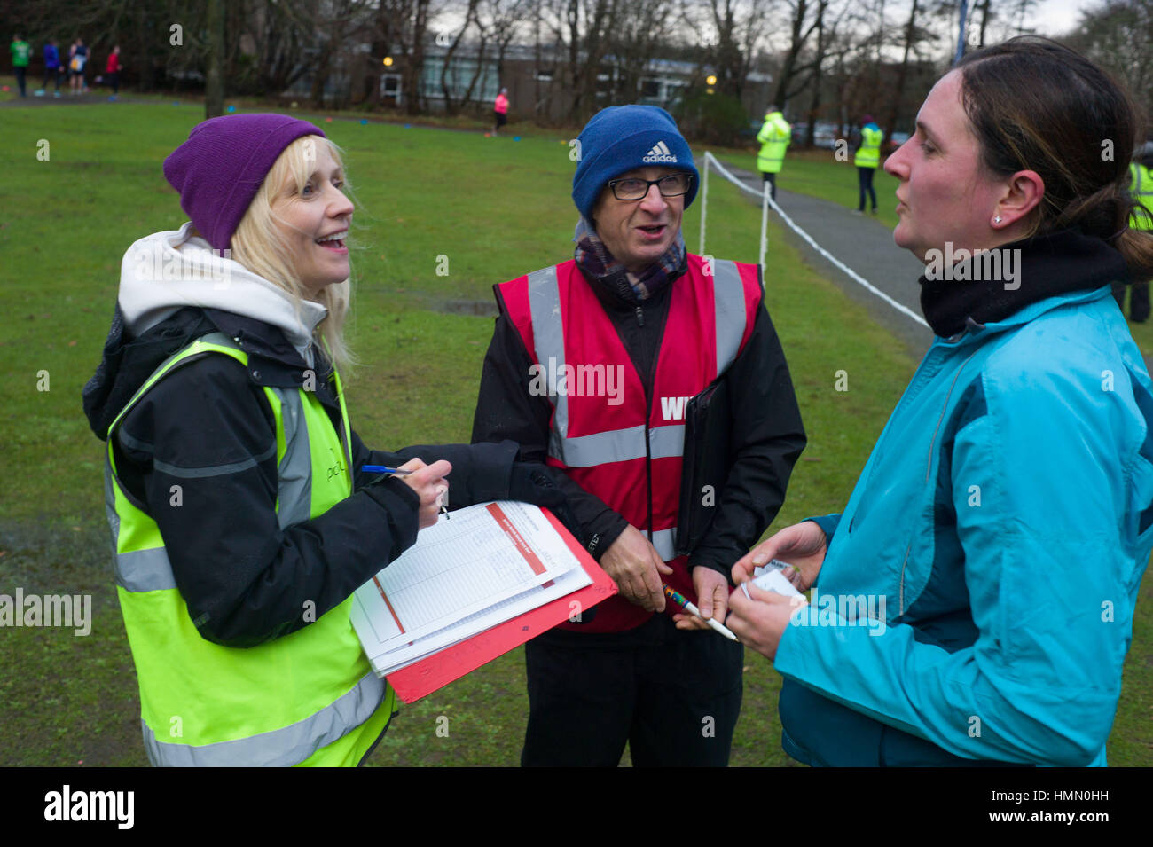 Aberdeen, UK. 4th February, 2017. Volunteer organisers and helpers at the Aberdeen weekly Park Run on a wet Saturday - Stock Image