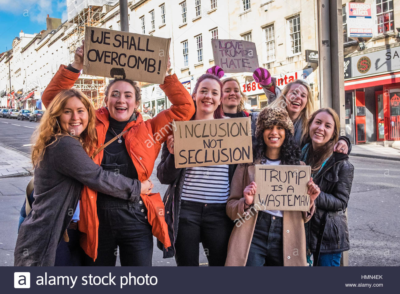 Bristol, UK - 04 February 2017:  Group of young women  wave banners and march through the city of Bristol, UK, protesting - Stock Image