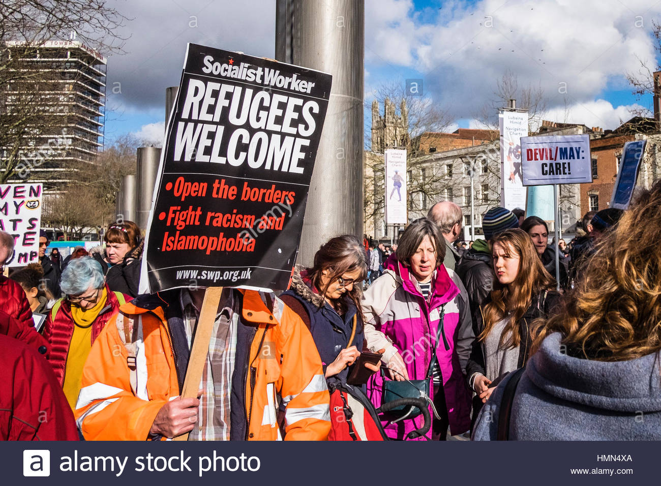 Bristol, UK - 04 February 2017:  Crowds of people wave banners in support of refugees and march through the city - Stock Image