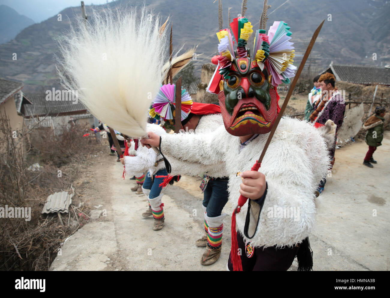 (170210) -- LONGNAN, Feb. 10, 2017 (Xinhua) -- Villagers perform Chigezhou, or 'Dance for the Gods of Mountains', - Stock Image