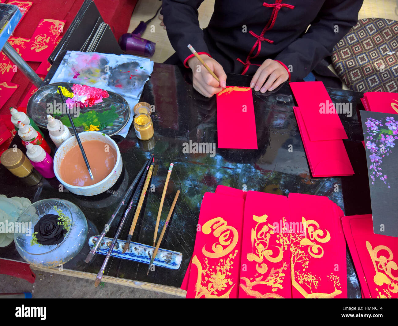 The scholar is writing the parallel sentences for Tet holiday - Stock Image