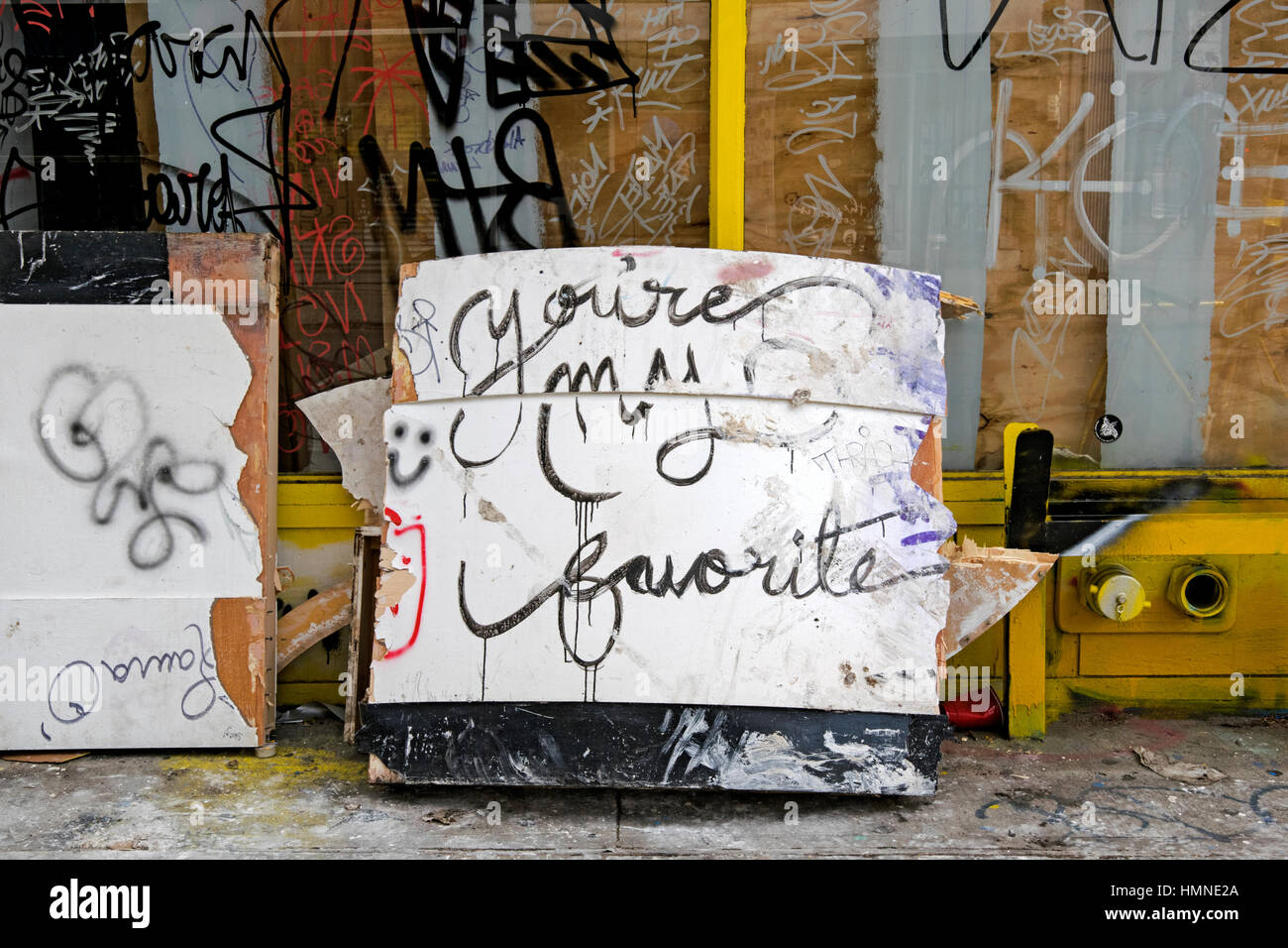 A pile of trash on Orchard Street on the Lower East Side street with a hand written message YOUR ARE MY FAVORITE. - Stock Image