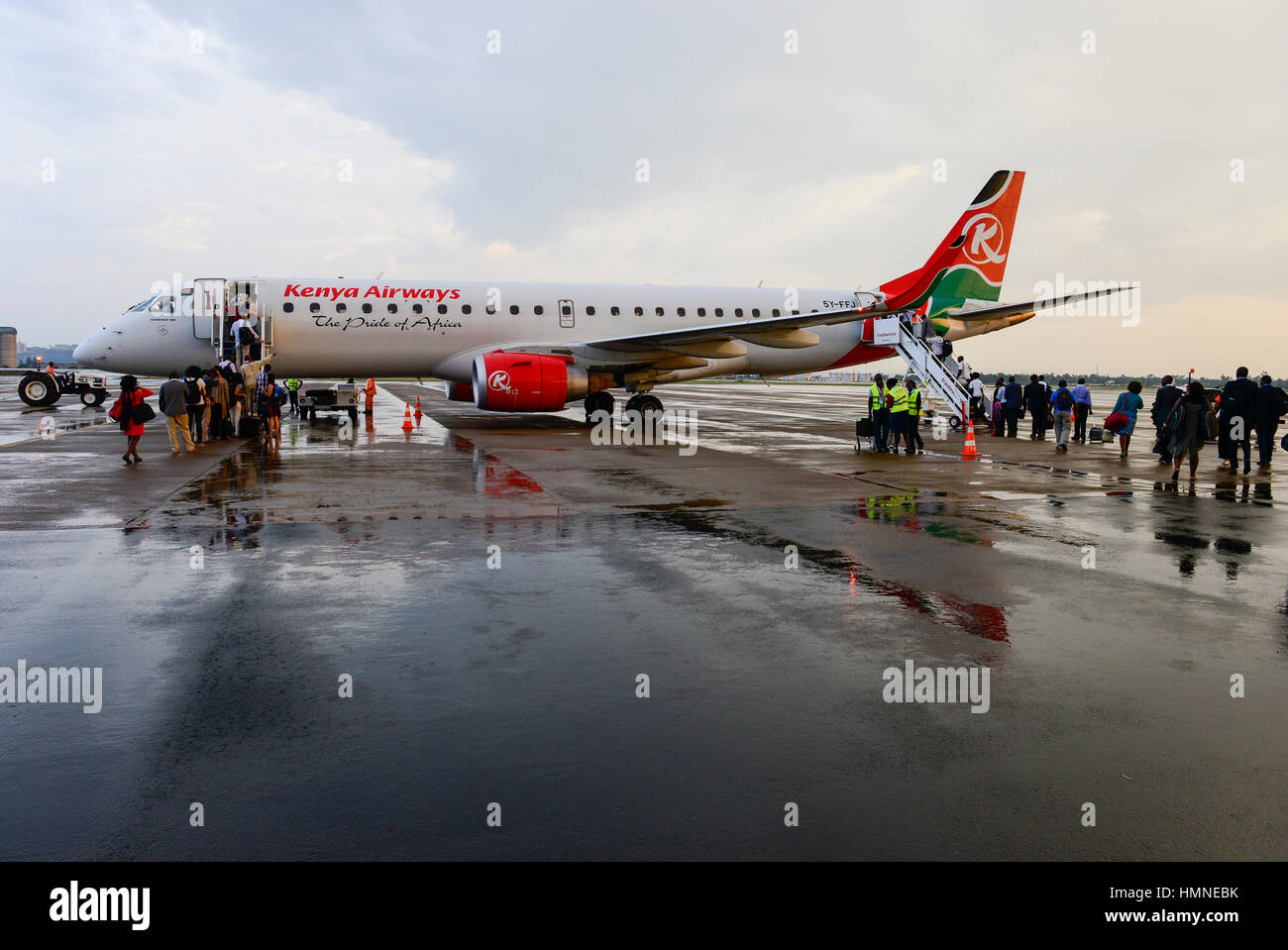 KENYA, Nairobi, JKIA Jomo Kenyatta International airport, passenger board a Kenya Airways aircraft Embraer 190 after - Stock Image