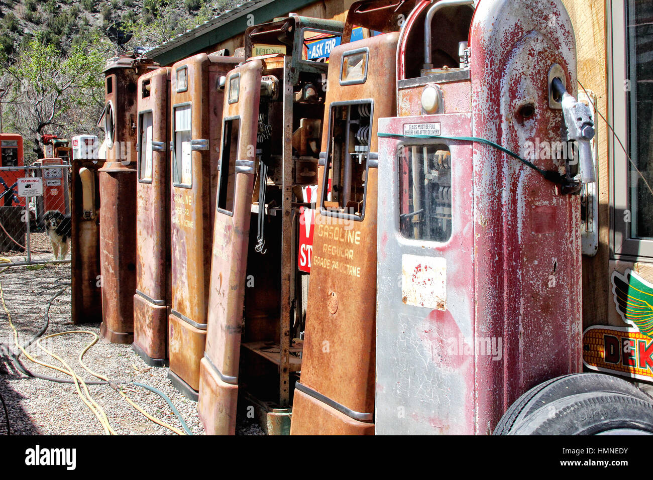 Gasoline Alley - Classical Gas on the Low Road to Taos in New Mexico features historic autos and related memorabilia - Stock Image