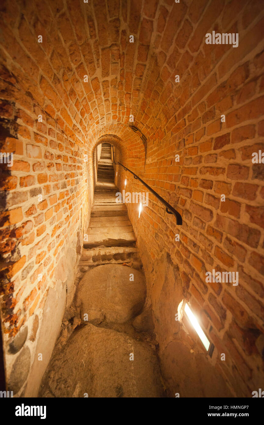 Narrow stairs old brick arched long corridor in Royal Castle of Warsaw in Poland, Europe - Stock Image