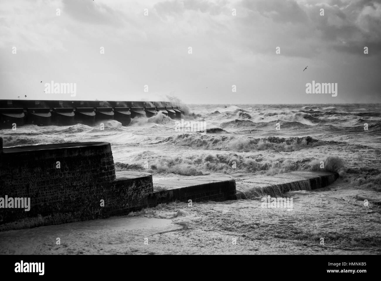 Stormy seas at Brighton Marina b/w. 2015. - Stock Image