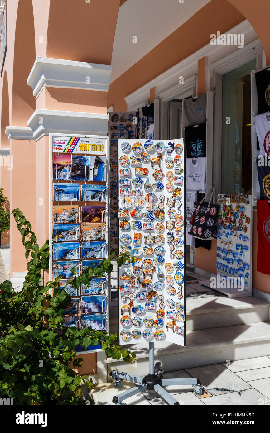 Fridge magnets, postcards and souvenirs at a shop in Oia, Santorini, a Mediterranean Greek Island in the Cyclades - Stock Image