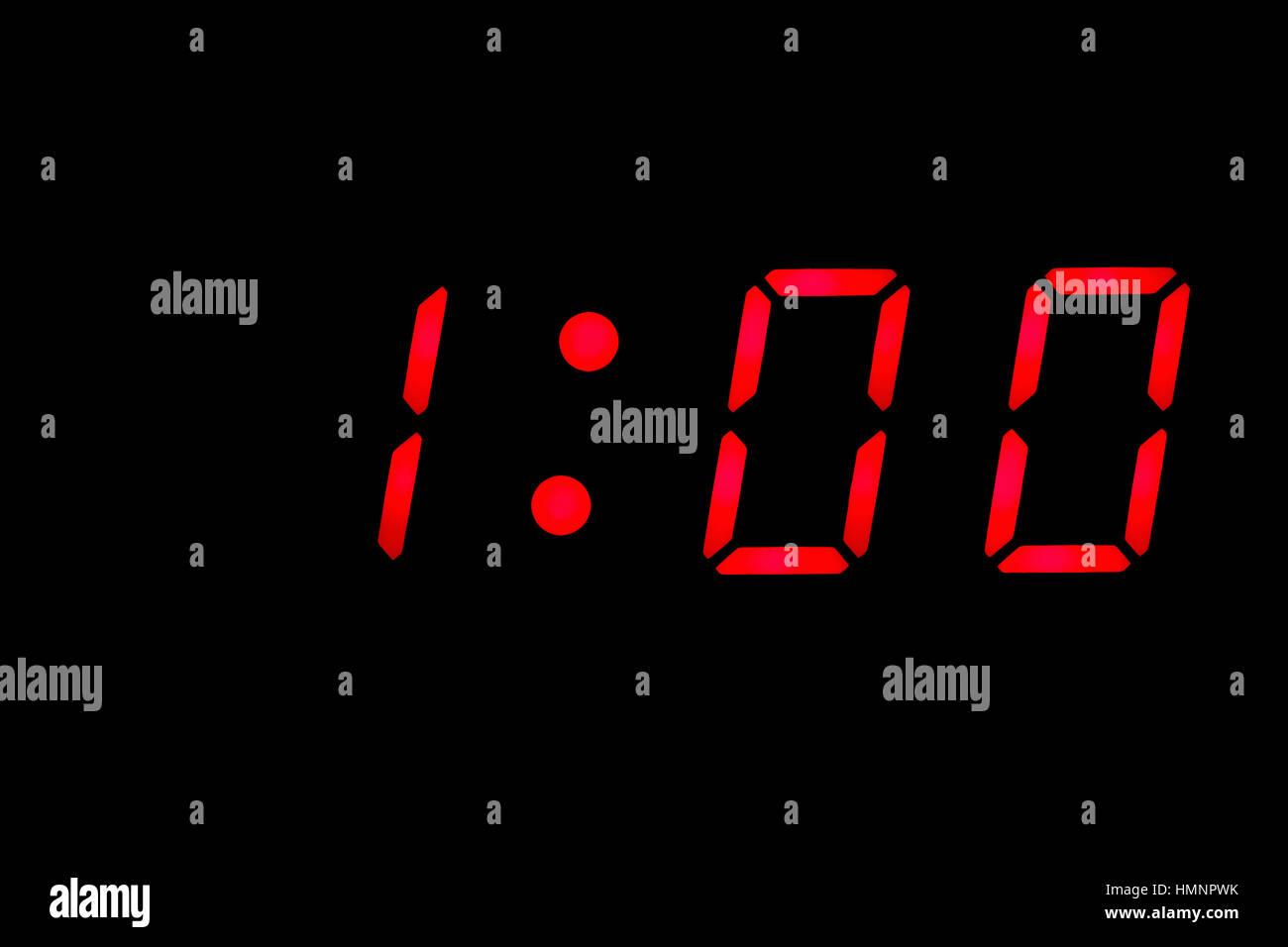 Digital clock closeup displaying 1:00 o'clock - Stock Image