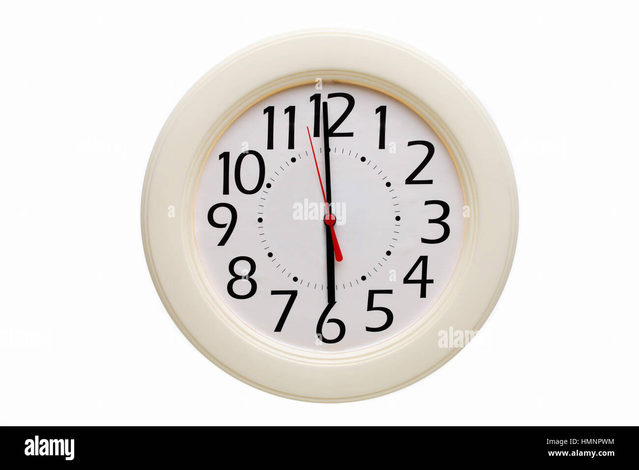 White analog wall clock showing 6:00 o'clock on white background - Stock Image