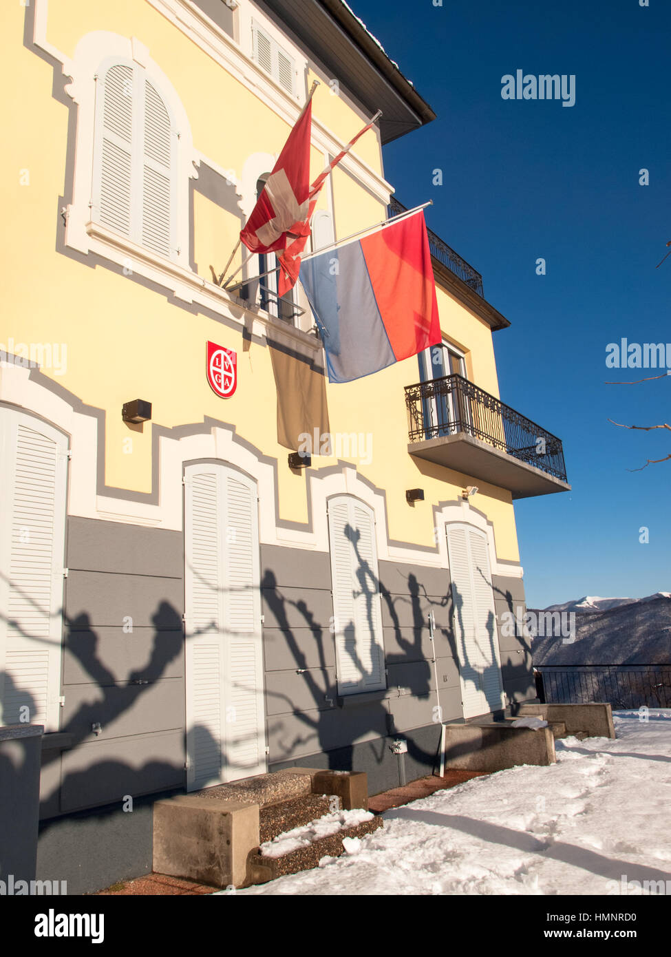 Monte Bré, Switzerland - February 22. 2015: Winter landscape from Monte Bre. View of the facade sunlight restaurant's - Stock Image